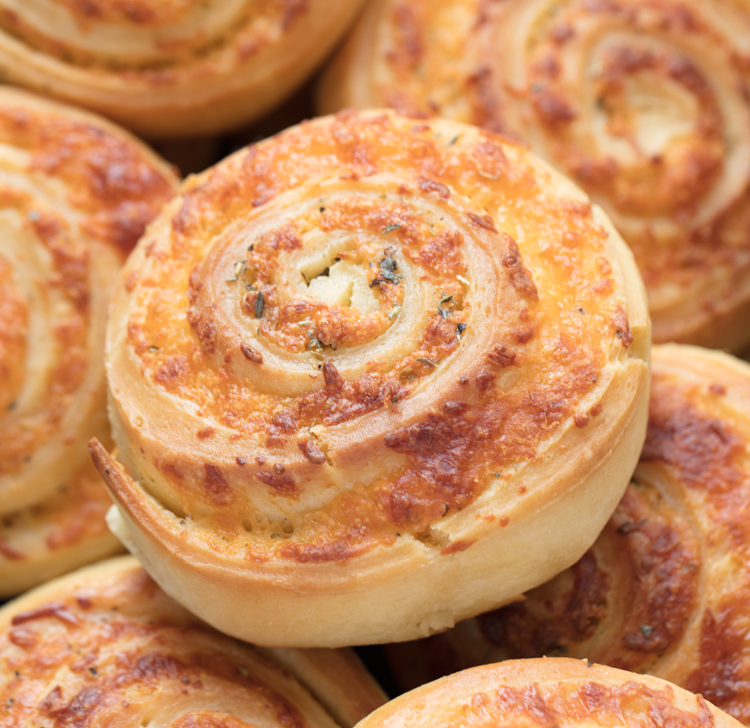 Homemade roll dough swirled with delicious cheese and spices. Perfect side to serve with soup!