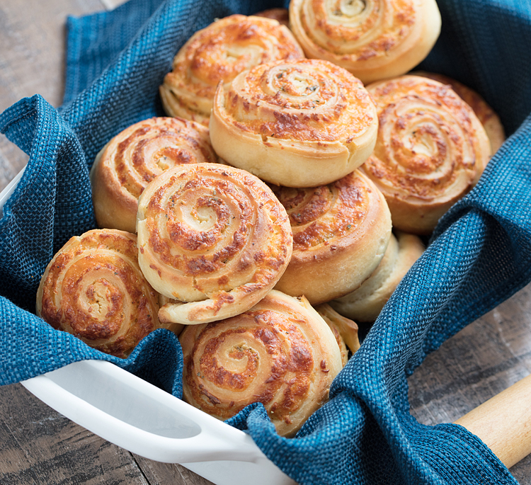 Soft bread dough made from scratch is stuffed with ooey gooey cheese and savory spices to create these delicious homemade cheese rolls. Pair with a bowl of hearty soup and you've got the perfect comfort food meal.
