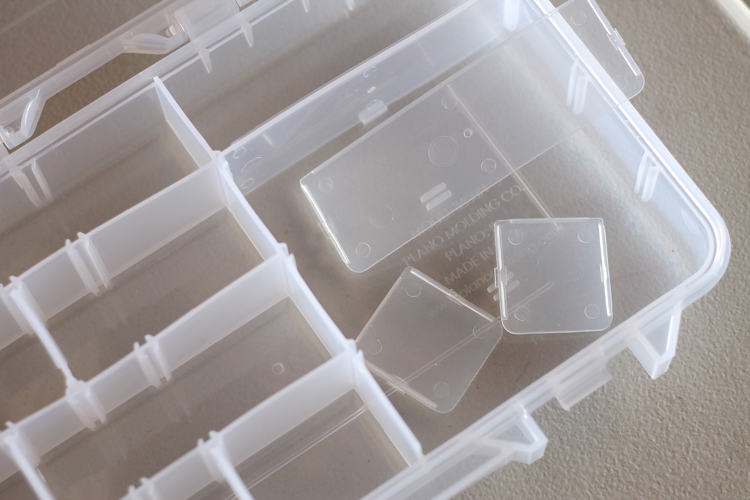 Use craft storage boxes to organize nails and screws
