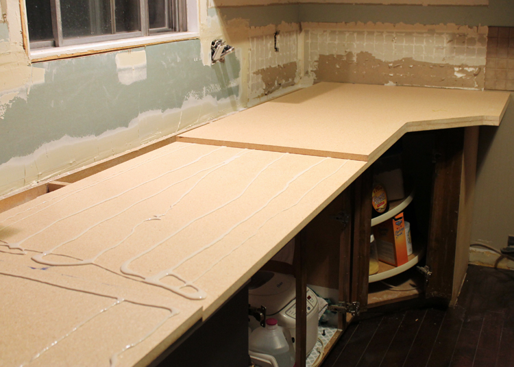 Rough Cut Laminate. Cut Strips Of Laminate To Cover The Edges Of The  Countertop, Then Cut A Big Piece To Go On Top. Leave At Least Two Inches Of  Overhang On ...