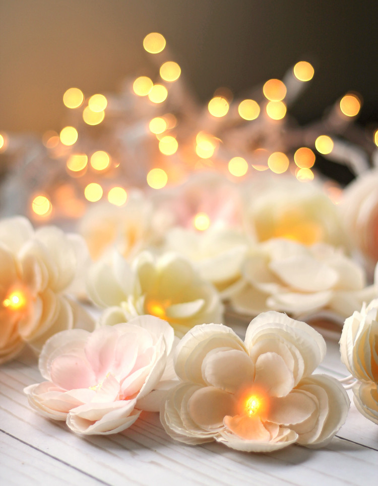 learn to make a pretty garland using silk flowers and white christmas lights