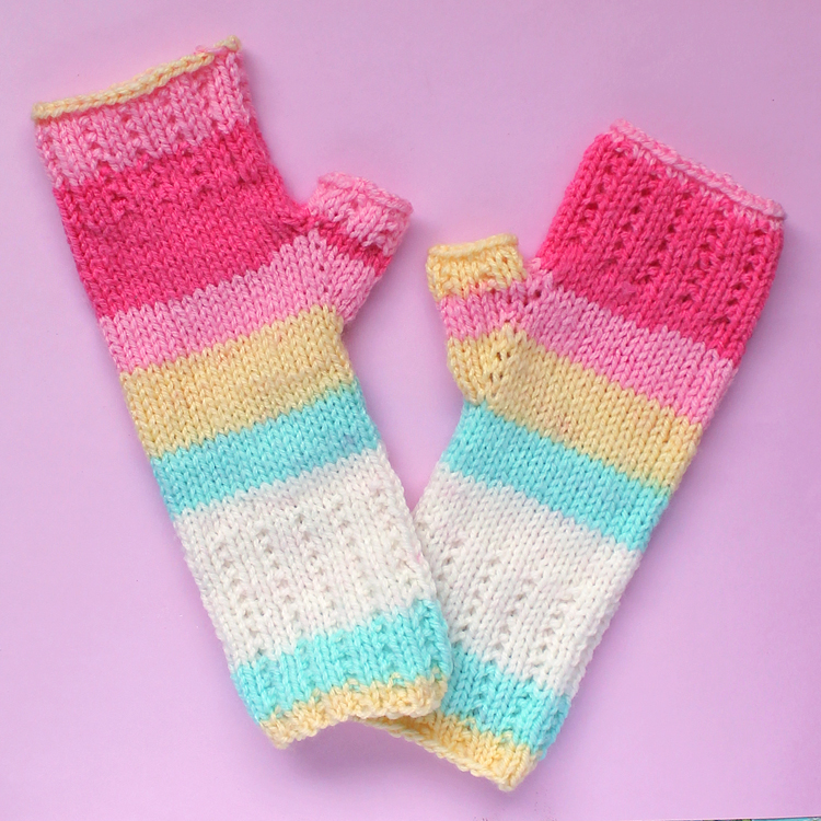 Self-striping yarn adds a pop of fun to these cute knitted gloves.