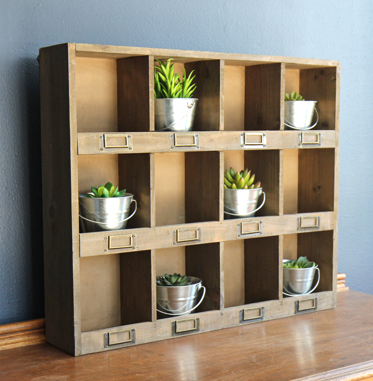 Display succulents or herbs on this pretty wooden shelf
