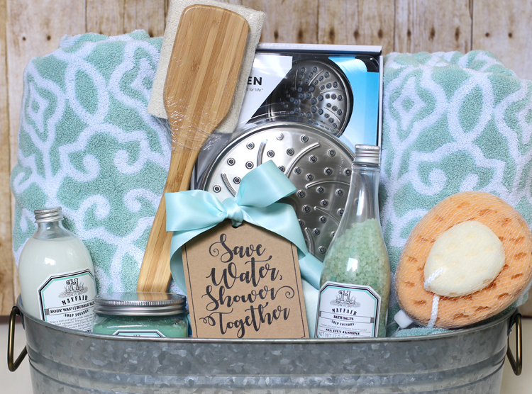 Shower themed diy wedding gift basket idea thecraftpatchblog the gift basket also includes big fluffy bath towels hand towels theyre stuffed down in the bottom to prop up the smaller items a back scrubber negle Images
