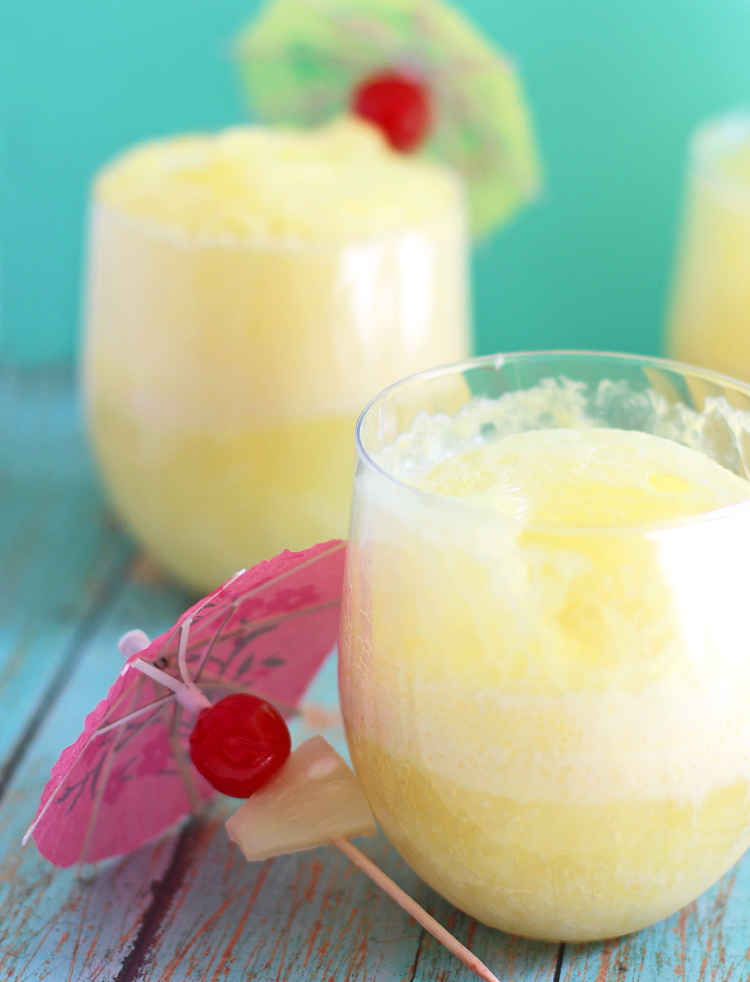 A fruity summer drink with coconut, pineapple, cherry and ice cream