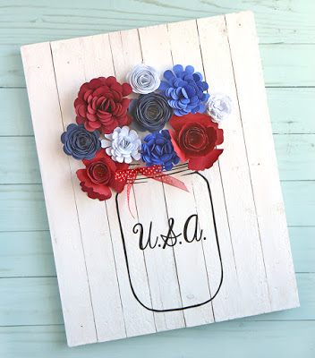 Mason jar sign filled with paper flowers