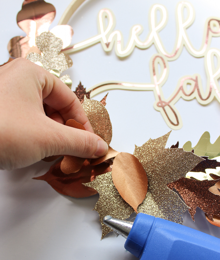 Gorgeous metallic paper leaves are used in this easy fall wreath idea
