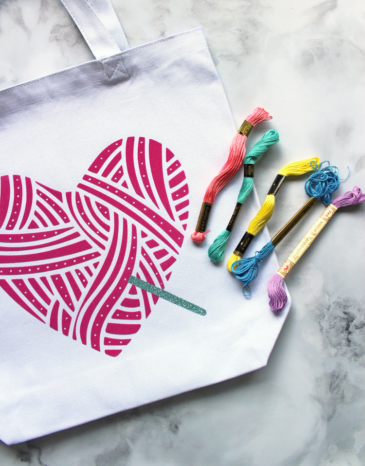Mix embroidery with heat transfer vinyl to make a cute DIY tote bag