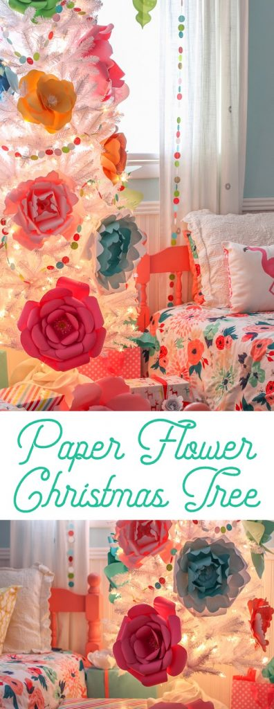 create a whimsical and colorful christmas tree decorated with a rainbow of giant paper flowers