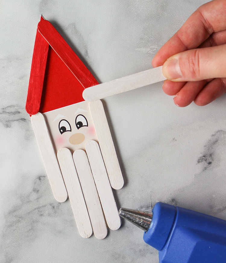 Make these cute Santa holiday ornaments with craft sticks