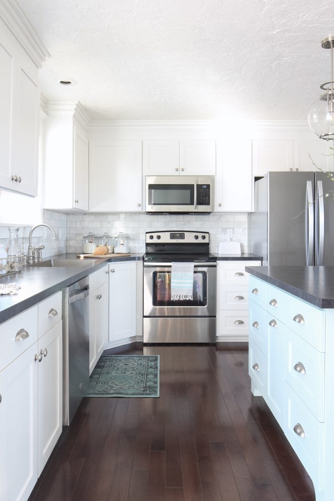 White Shaker Kitchen Cabinets, Blue Island, Marble Backsplash, Black Countertops