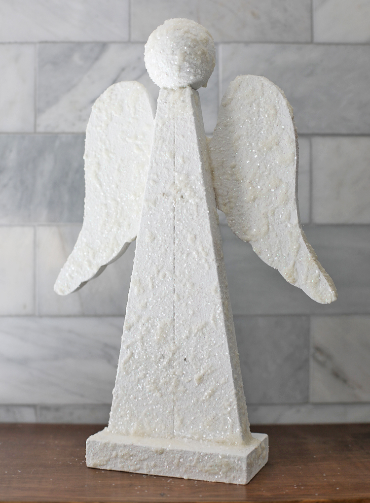 A wooden angel painted to look like snow
