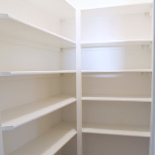 Floor to Ceiling L-Shaped Shelving That's Strong and Cheap To Build