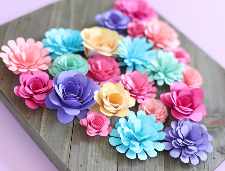 paper flowers on wood sign