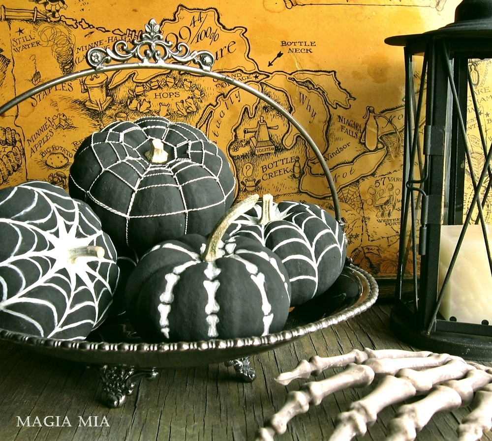 black and white spooky painted pumpkins