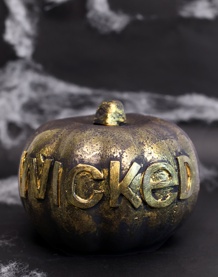 spooky word painted pumpkin