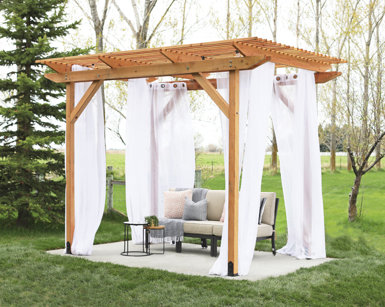 redwood pergola with curtains