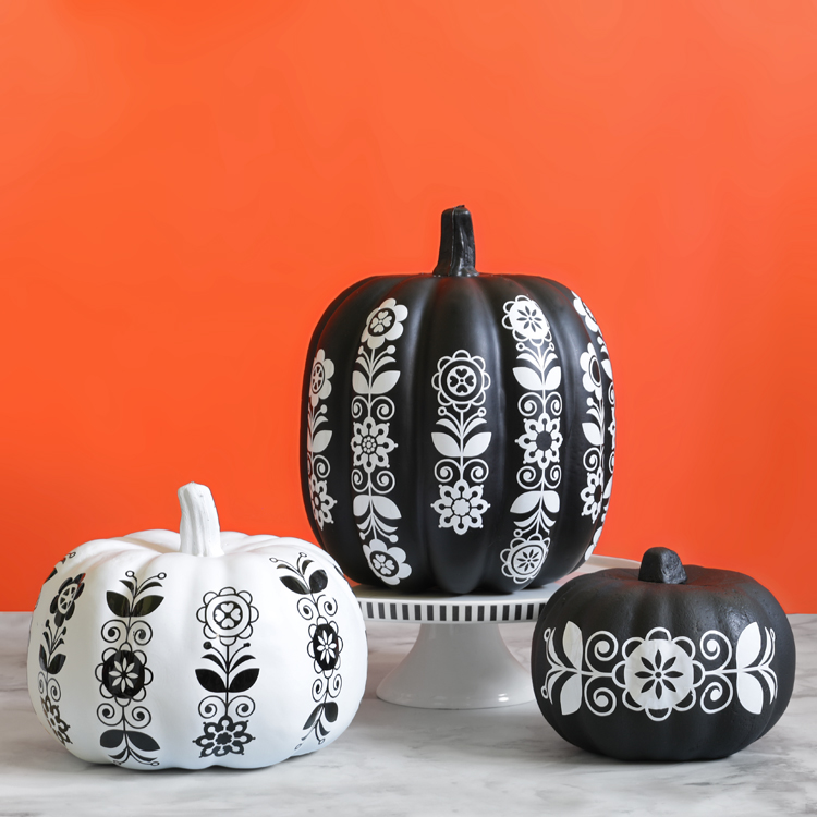 folk art black and white decorated pumpkins