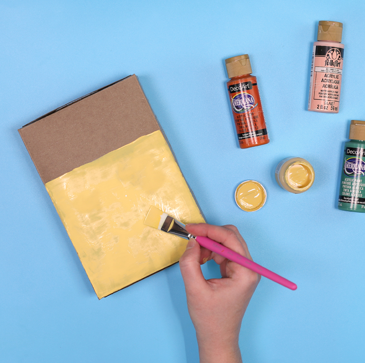 paint a recycled cereal box