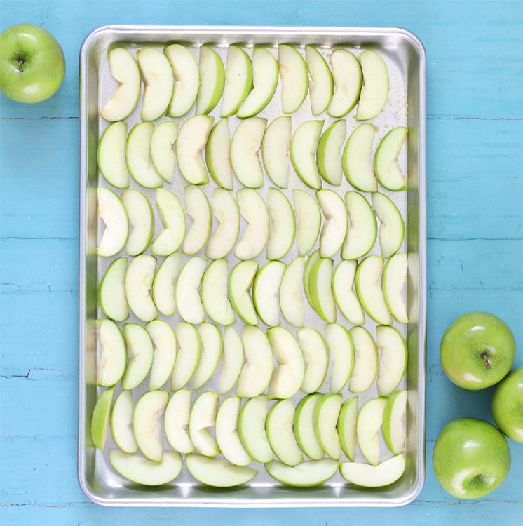 sliced apples on a cookie sheet