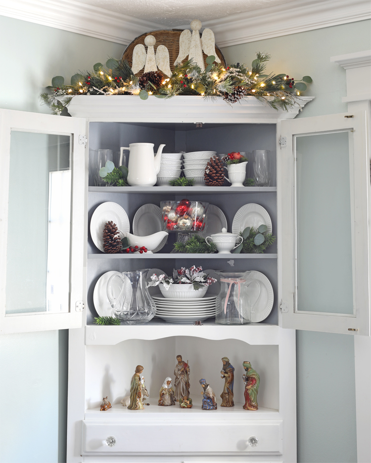 corner hutch decorated for christmas
